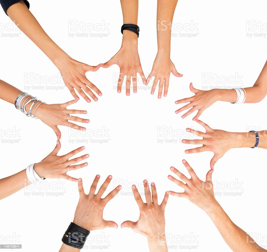 Hands together in a circle against white background royalty-free stock photo
