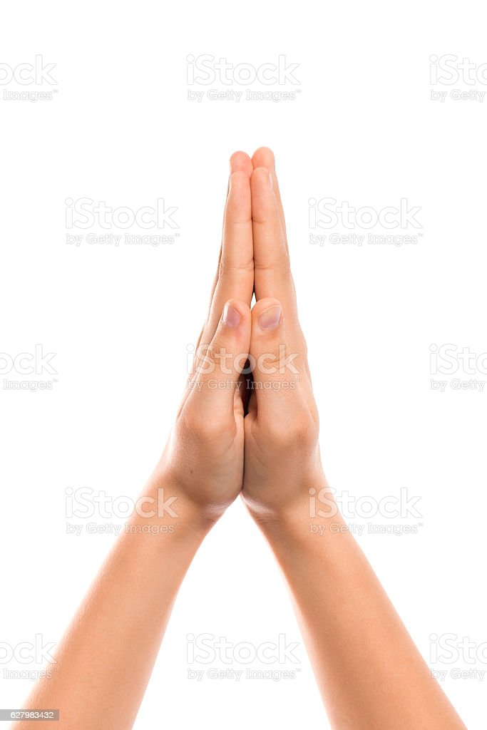 Hands together in prayers stock photo