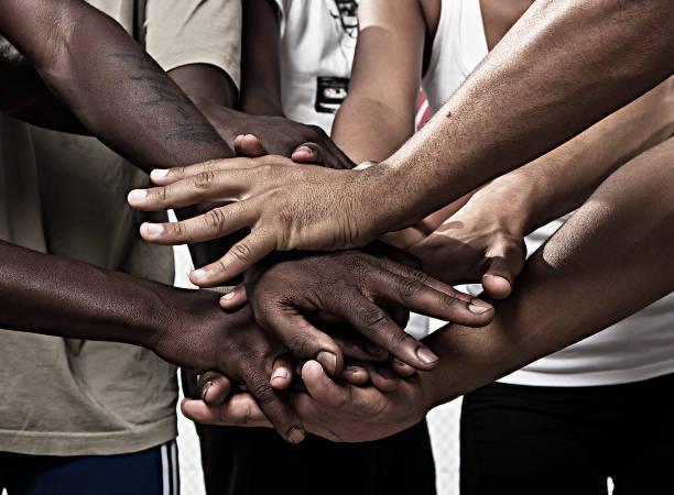 hands together in union - mano donna dita unite foto e immagini stock