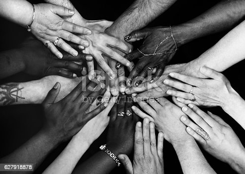 Male and female hands of various ethnicities all together. Monochrome.