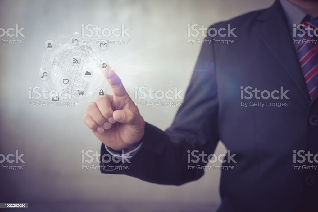Hands touching global connection and icon customer networking data exchanges on dark background stock photo