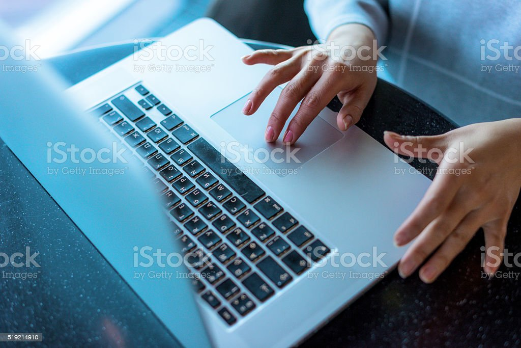 Hands typing on a notebook stock photo