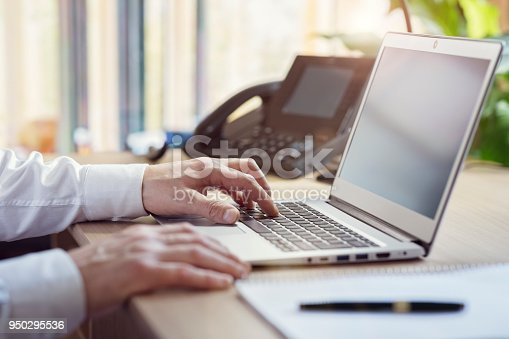 istock Hands typing on laptop computer in office 950295536