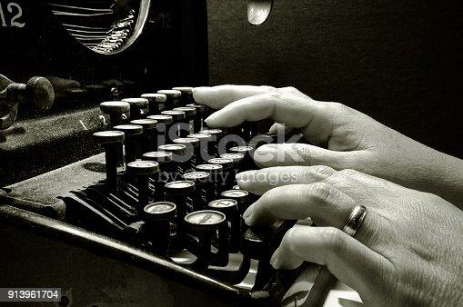 istock Hands typing on old typewriter keyboard 913961704