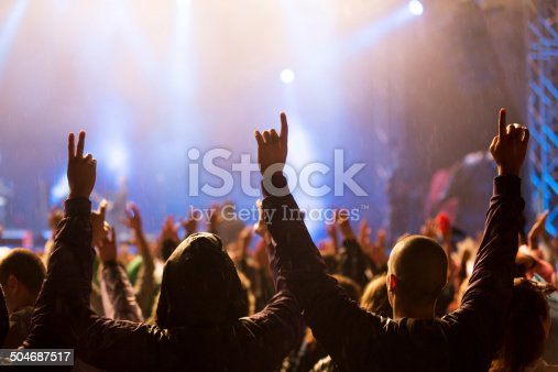 1069137774 istock photo Hands up at the concert 504687517