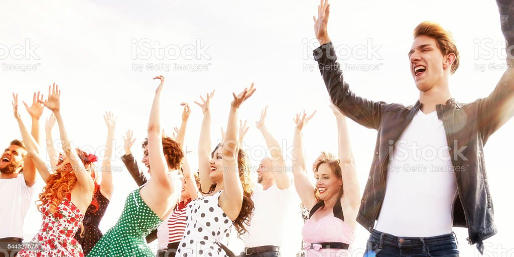 Hands Up Dancers Waving Arms at  Fifties High School Dance stock photo