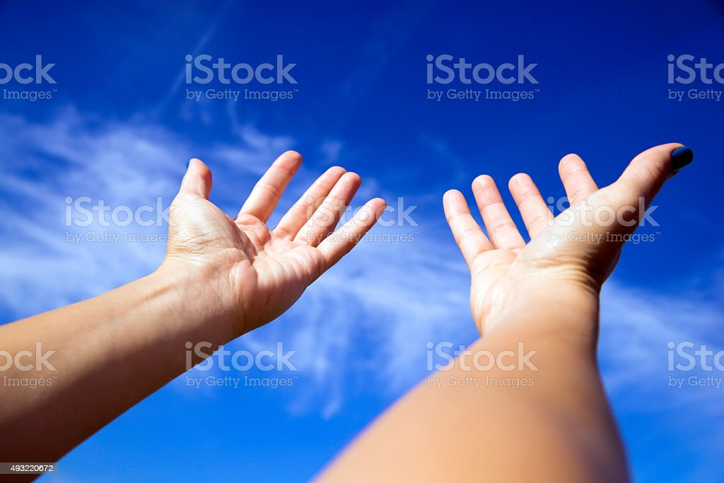 Hands up in the sky, Worship stock photo