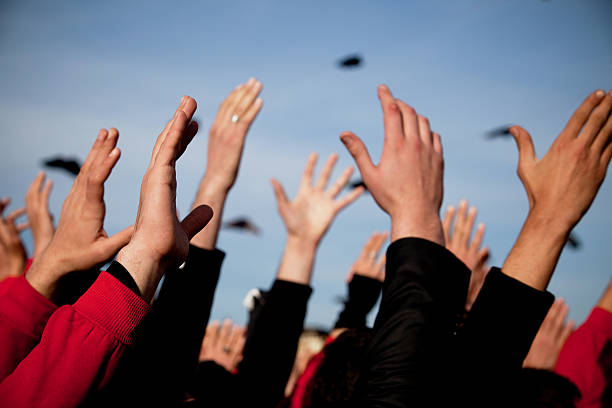 Hands Up Group of people with arms raised above heads, close-up of hands activist stock pictures, royalty-free photos & images