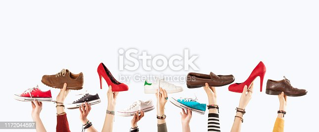 hands up with many shoes