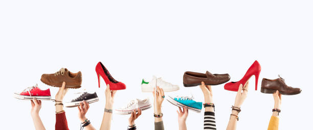 hands up with many shoes - men shoes stock pictures, royalty-free photos & images