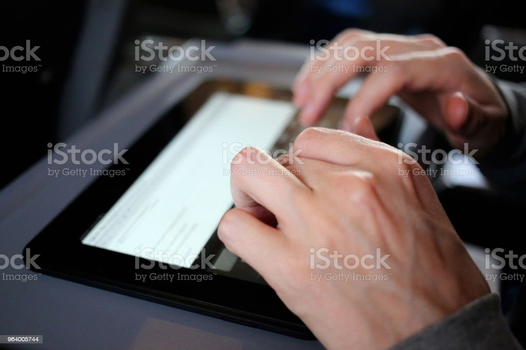 Hands using a digital smart tablet - Royalty-free Adult Stock Photo