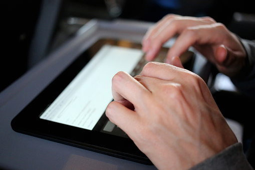 Hands Using A Digital Smart Tablet Stock Photo - Download Image Now