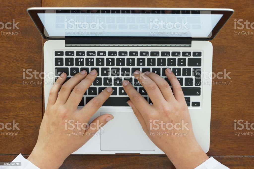 Hands using a laptop stock photo
