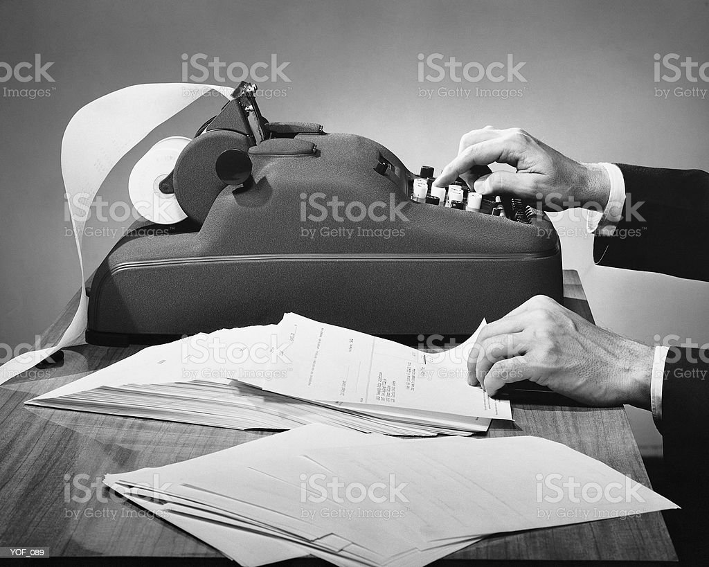 Hands using adding machine royalty-free stock photo