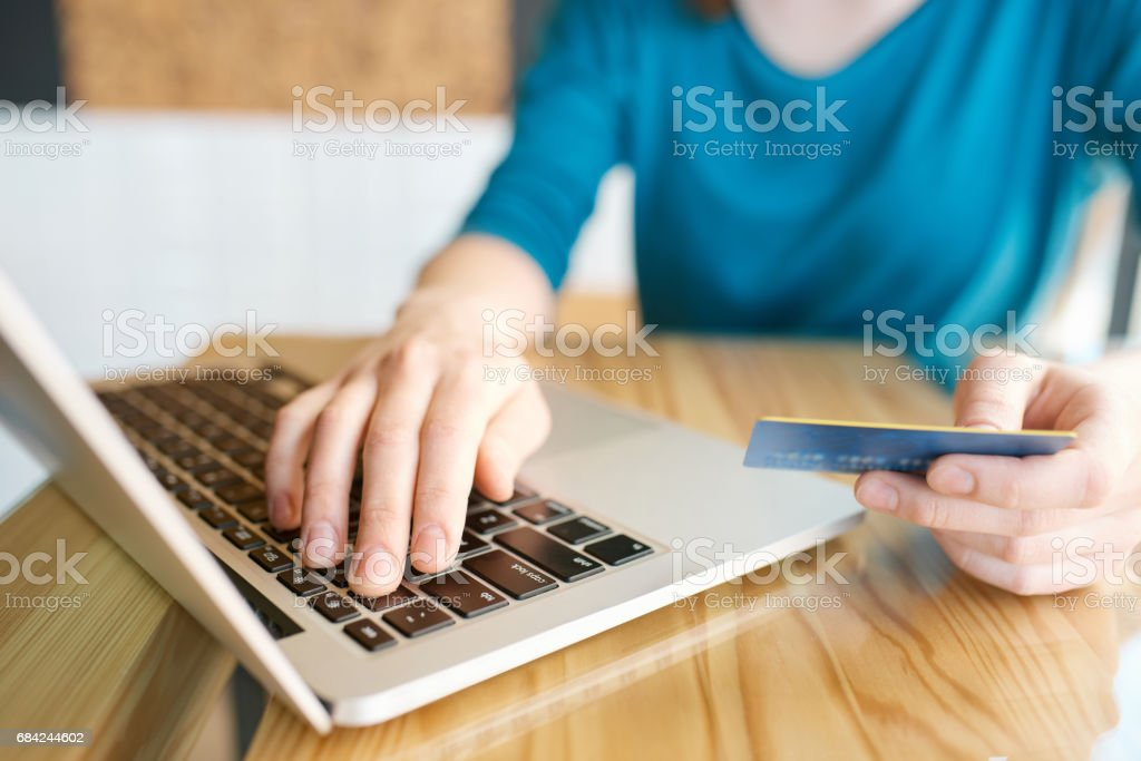 Hands using computer and credit card royalty-free stock photo