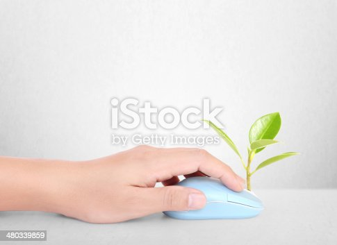 istock hands using  mouse with  plant 480339859