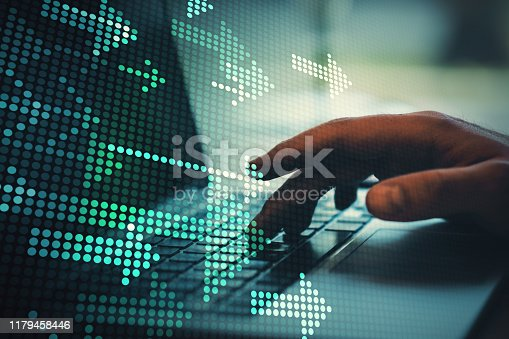 istock Hands using notebook with arrows 1179458446