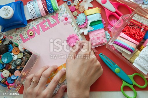 istock Hands using scrapbooking tools with the word lovely 171149056