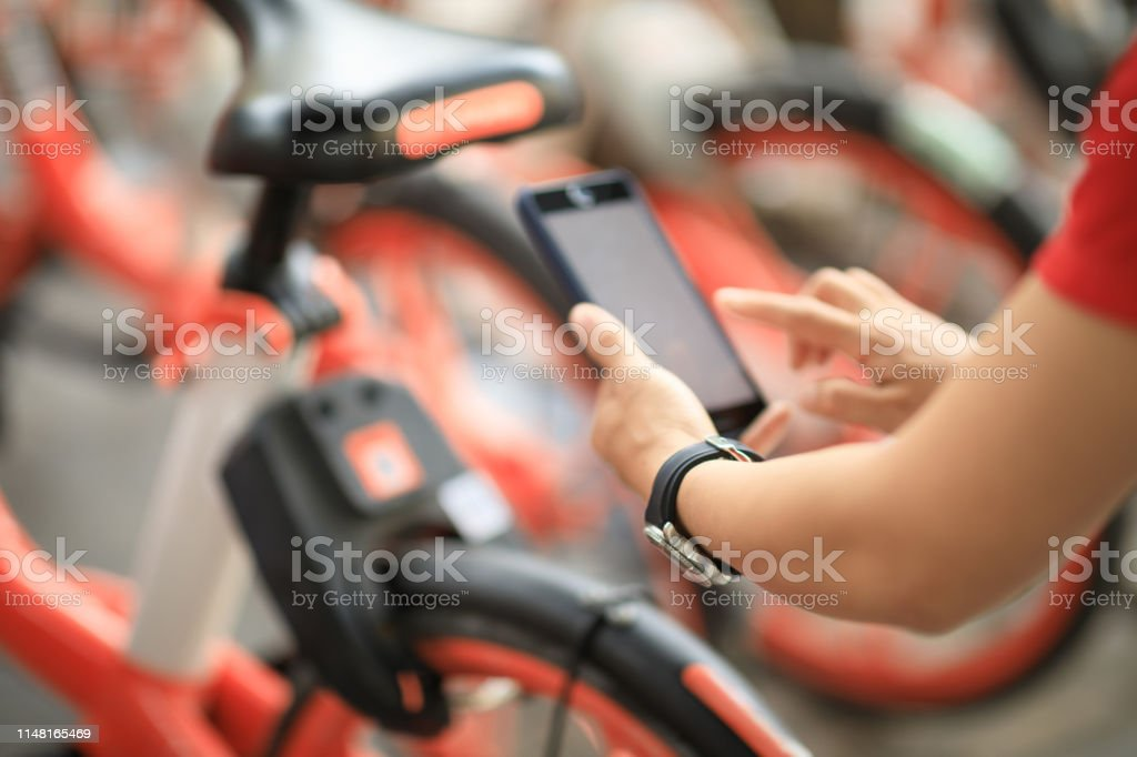 Hands Using Smartphone Scanning The Qr Code Of Shared Bike