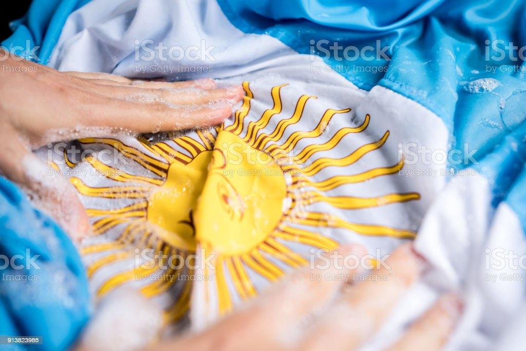 Bandera de Argentina - Argentina/corrupción concepto de lavado de manos - foto de stock