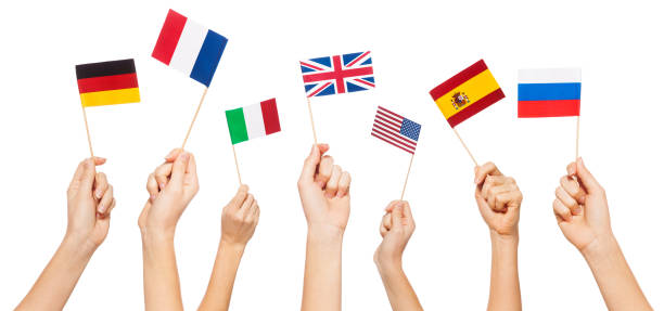 Hands waving flags of USA and EU member-states Hands waving small paper flags of USA and European Union member-states, isolated on white Anglo American stock pictures, royalty-free photos & images