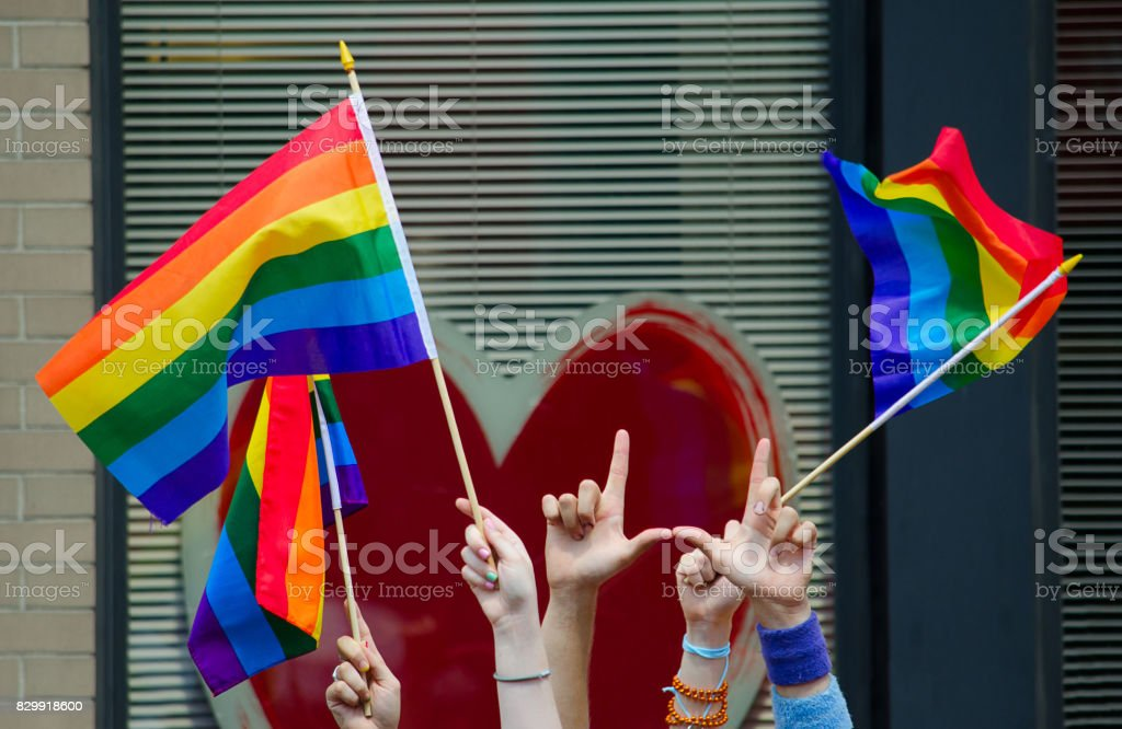 Hands Waving Gay Flags Stock Photo - Download Image Now