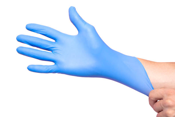 Hands wearing a blue latex glove, isolated on white background Hands wearing a blue latex glove, isolated on white background latex stock pictures, royalty-free photos & images
