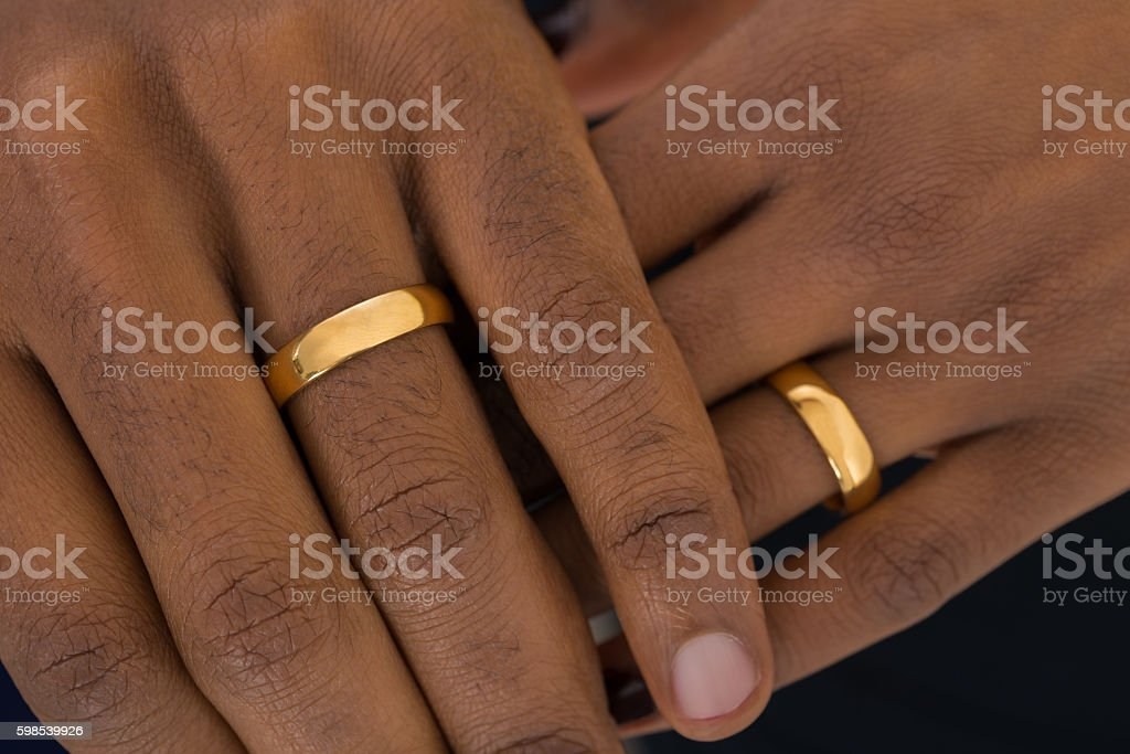 Hands Wearing Golden Rings stock photo