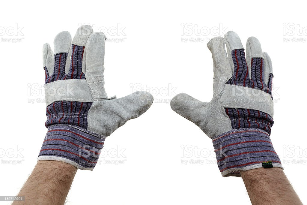 hands wearing work gloves stock photo