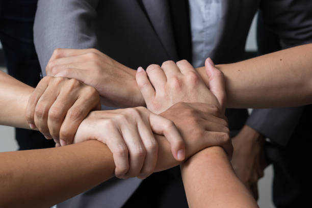 Hände waren ein Kooperationskonzept der Teamarbeit – Foto