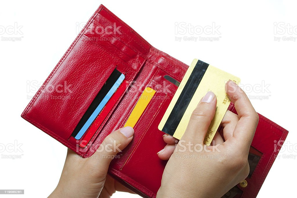 Hands with a purse and card royalty-free stock photo