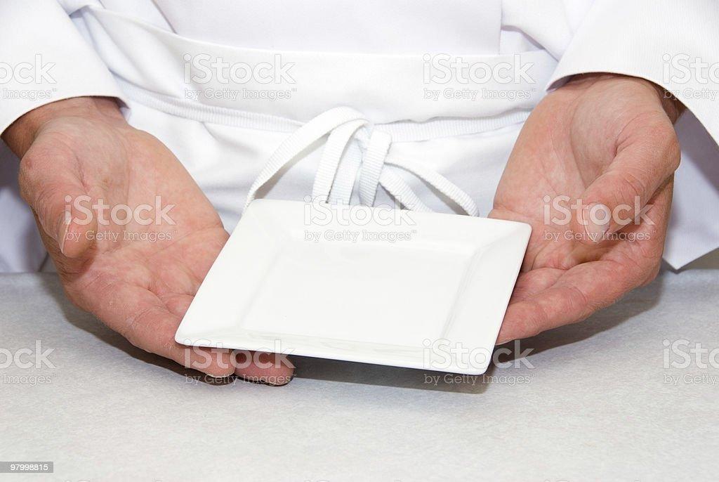 Mãos com um prato vazio square foto royalty-free