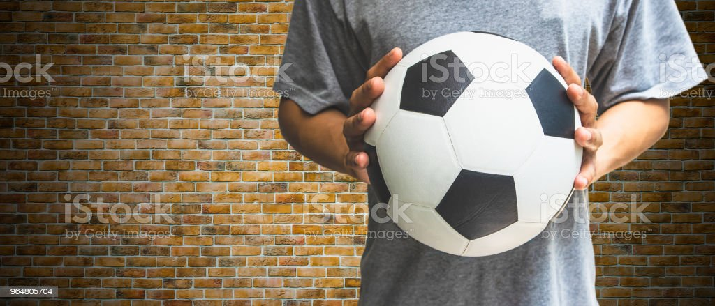 Hands with a soccer ball isolated on white royalty-free stock photo