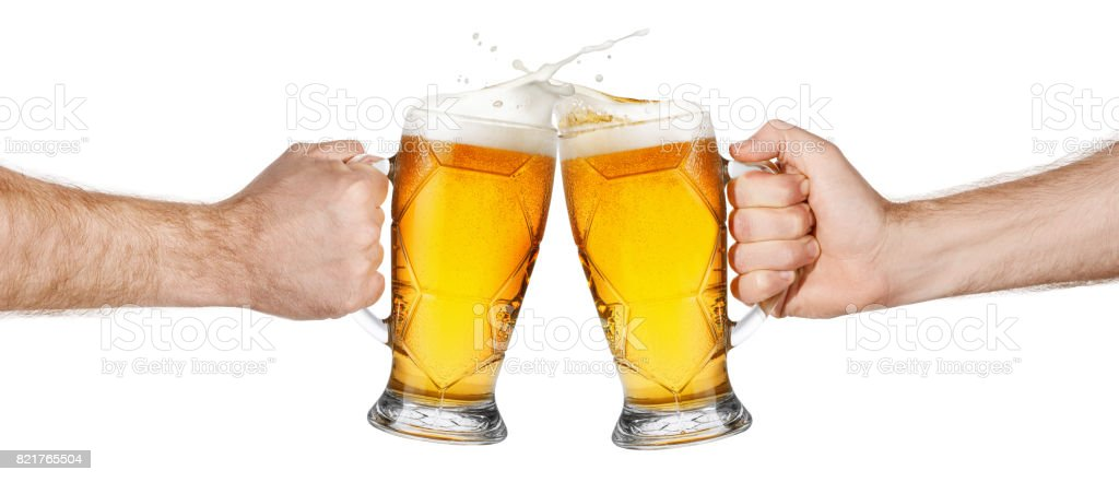 hands with beer mugs making toast stock photo