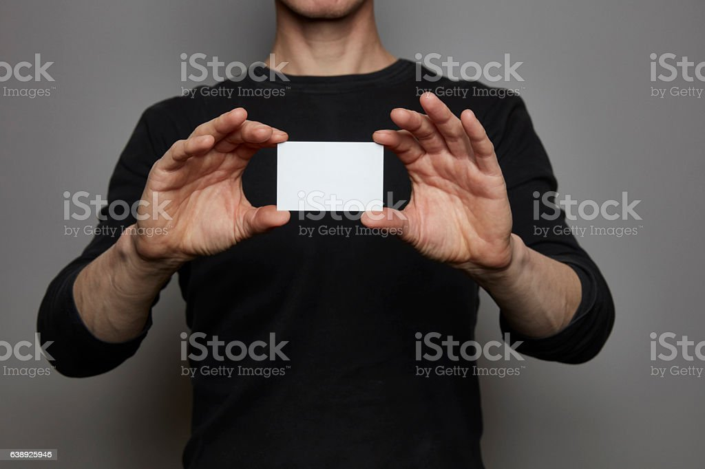 Hands with business card / sign holder stock photo