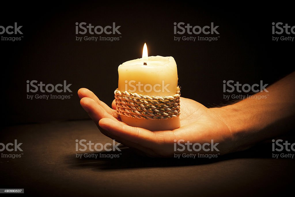 Hands with candle royalty-free stock photo