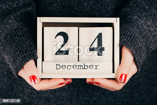 istock Hands with Christmas Eve date 888103146