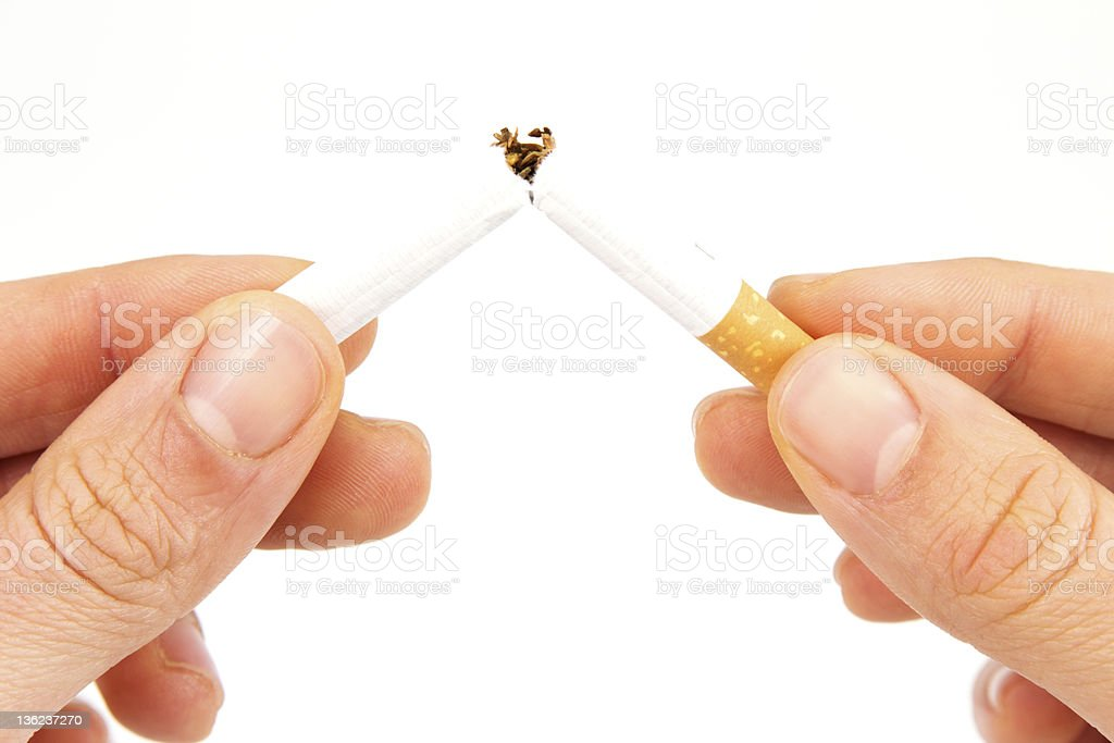 Hands with cigarette stock photo