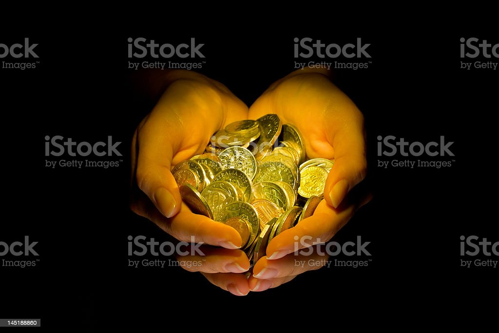 Hands with coins over black royalty-free stock photo