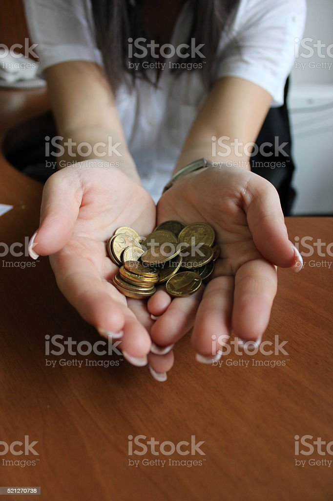 Hands with coins stock photo