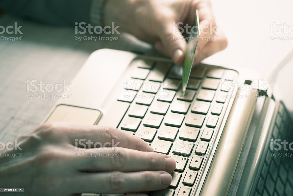 Hands with credit card and notebook horizontal stock photo
