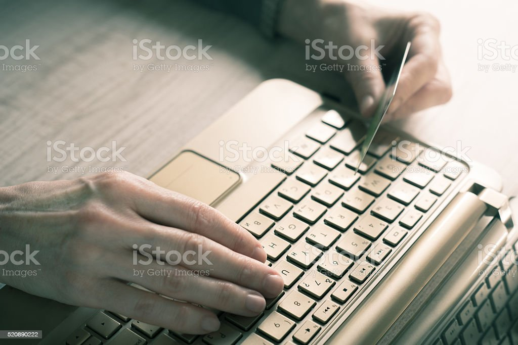 Hands with credit card and notebook stock photo
