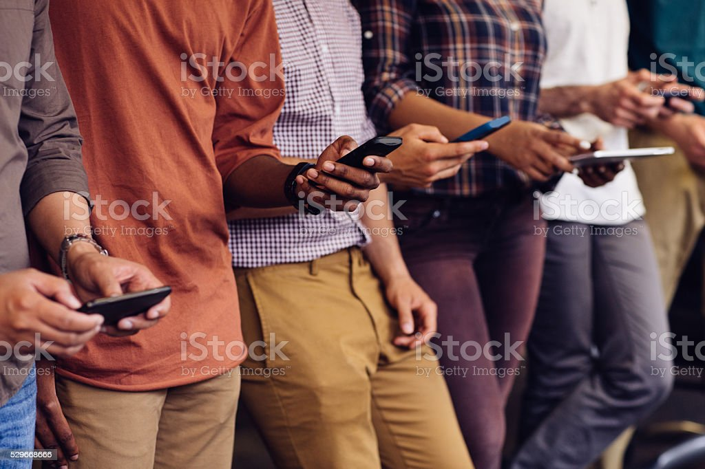 Hands with devices stock photo