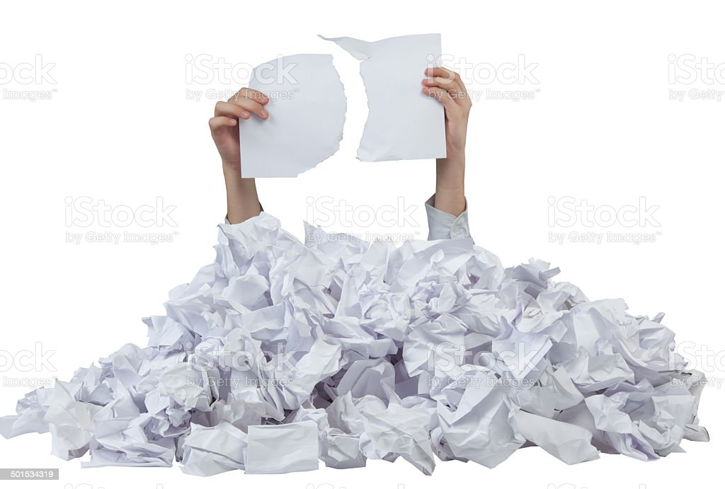 Hands with empty lacerated paper reaches out from crumpled papers stock photo
