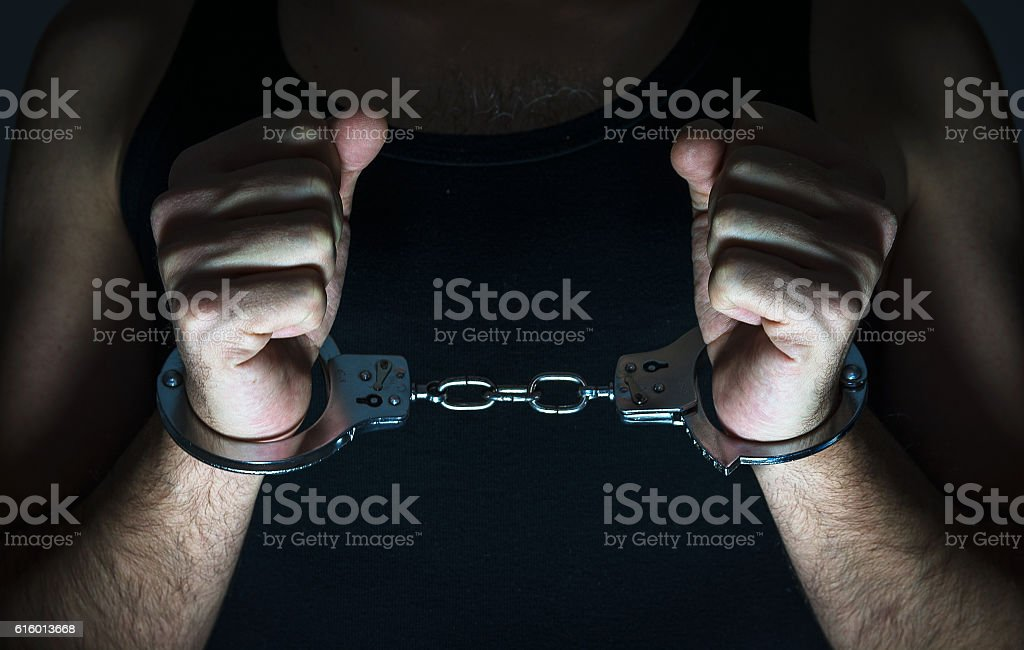 Hands with handcuffs stock photo