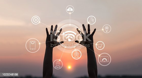 istock Hands with innovative icon and development of telecommunication, network connection in global communication networking on sunset background. 1023248158