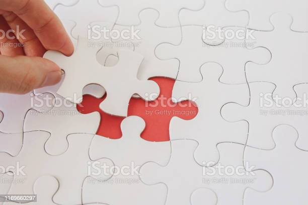 Hands with jigsaw puzzle pieces business strategy planning alzheimers picture id1169660297?b=1&k=6&m=1169660297&s=612x612&h=2a 8qf0bqi6zyk8qeydydmz5su3rau6oehqurkubqoi=