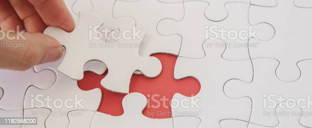 Hands with jigsaw puzzle pieces business strategy planning alzheimers picture id1182568200?b=1&k=6&m=1182568200&s=612x612&h=nezm4mwqei  rx9sxuc 8ysygcbagmpw5pcnpq 2zlo=