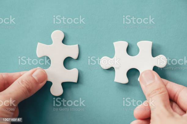 Hands with jigsaw puzzle pieces business strategy planning alzheimers picture id1207169187?b=1&k=6&m=1207169187&s=612x612&h=hwfk8wbdhmmtt9dlosbngupipnuliz68ntdg2gsm6fy=
