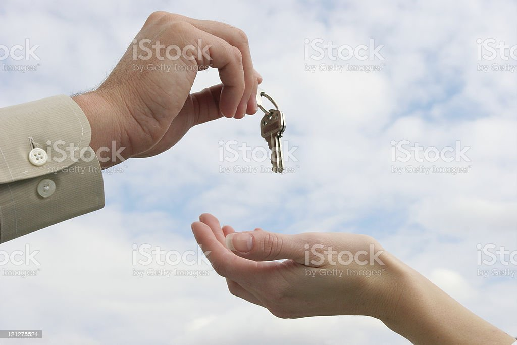 Hands with keys- Handing over the keys - royalty-free stock photo